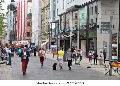 LEIPZIG, GERMANY - MAY 9, 2018: People shop at Grimmaische Street in Leipzig, Germany. Leipzig is the 10th biggest city in Germany with 582,277 inhabitants.
