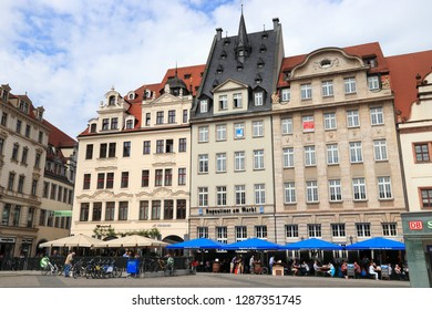 LEIPZIG, GERMANY - MAY 9, 2018: People visit Markt square in Leipzig, Germany. Leipzig is the 10th biggest city in Germany with 582,277 inhabitants.