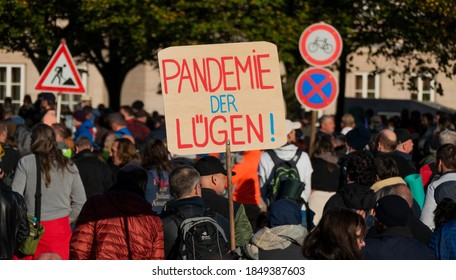 """Leipzig, Germany - November 07, 2020: Demonstrations in connection with the coronavirus measures of the German government, banners with the inscription """"Pandemic of lies"""""""