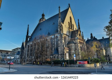 Leipzig, Germany - November 14, 2018. Exterior view of St. Thomas Church (Thomaskirche) in Leipzig, with people and street traffic.