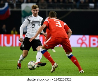Leipzig, Germany - November 15, 2018. German national football team striker Timo Werner against Russian defender Roman Neustaedter during international friendly Germany vs Russia in Leipzig.