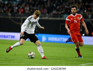 Leipzig, Germany - November 15, 2018. German national football team striker Timo Werner against Russian defender Georgi Dzhikiya during international friendly Germany vs Russia in Leipzig.