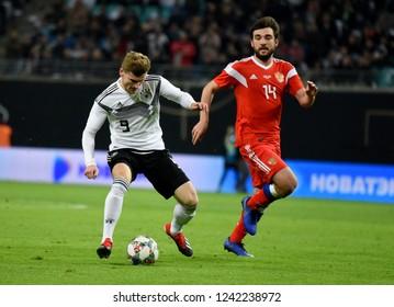 Leipzig, Germany - November 15, 2018. German national football team striker Timo Werner against Russian defender Georgi Dzhikiya during international friendly Germany vs Russia in Leipzig.