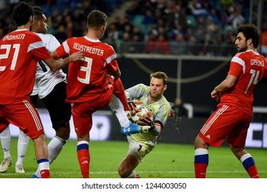 Leipzig, Germany - November 15, 2018. Germany national football team goalkeeper Manuel Neuer against Russian players Alexander Erokhin, Roman Neustaedter, Georgi Dzhikiya  in Germany vs Russia match.