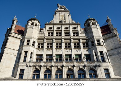 Leipzig, Germany - November 15, 2018. Facade of New Town Hall (Neues Rathaus) building in Leipzig with statues of lion and human figures symbolizing Craft, Justice, Book Art, Science and Musicю