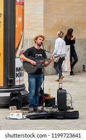 LEIPZIG, GERMANY – OCTOBER 06, 2018: singing street musician in the city center of Leipzig in Germany