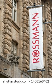 LEIPZIG, GERMANY – OCTOBER 07, 2018: Flag at a Rossmann branch in downtown Leipzig. The entrepreneur Dirk Rossmann opened his first drugstore in Hanover in 1972.