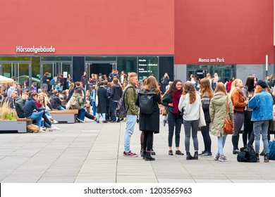 LEIPZIG, GERMANY – OCTOBER 08, 2018: young students on the university campus in Leipzig during a break
