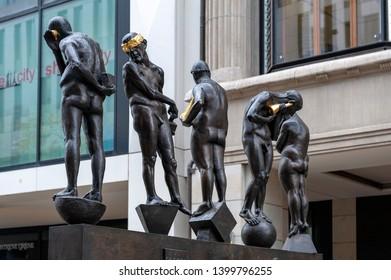 Leipzig, Germany - October 2018: Bronze sculptures titled Untimely Contemporaries by Bernd Goebel installed on Grimmaische Street near Augustusplatz in downtown Leipzig, Germany