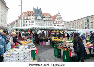 Leipzig, Germany - October 2018: Farmers Market where various kinds of fresh products from farms are sold at Marktplatz, the market square in city centre of Leipzig, Germany