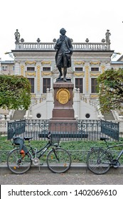 Leipzig, Germany - October 2018:  Memorial statue of Johann Wolfgang von Goethe in front of The Old Stock Exchange at Naschmarkt Plaza in Leipzig, Germany