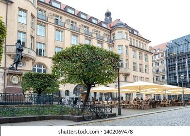 Leipzig, Germany - October 2018: Restaurant at Naschmarkt Plaza in front of the memorial statue of Johann Wolfgang von Goethe in Leipzig, Germany