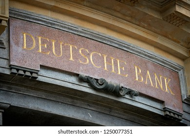 """LEIPZIG, GERMANY – OCTOBER 8, 2018: Lettering """"Deutsche Bank"""" at a historic bank building in the city center of Leipzig. The Deutsche Bank is located since 1901 in this building."""