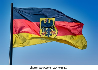 LEIPZIG, GERMANY - SEPTEMBER 26, 2021: Official flag of the federal authorities (German: Bundesdienstflagge) of the Federal Republic of Germany in black, red and gold, with federal shield and eagle