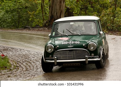 LEIRIA, PORTUGAL - APRIL 21: Jorge Almeida drives a Austin Cooper S during Day Two of Rally Verde Pino 2012, in Leiria,  Portugal on April 21, 2012.