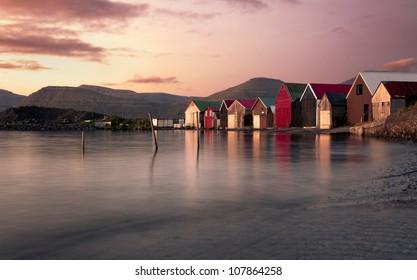 Leirvik harbor on Eysturou island of Faroe Islands/ Leirvik harbor at sunset.