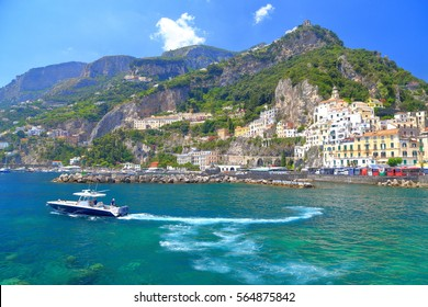 Leisure boats near the harbor of Amalfi town, Amalfi coast, Italy