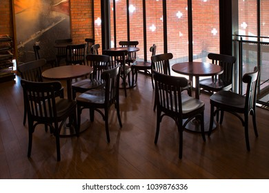 leisure corner with wood chairs and table on wooden floor in coffee shop