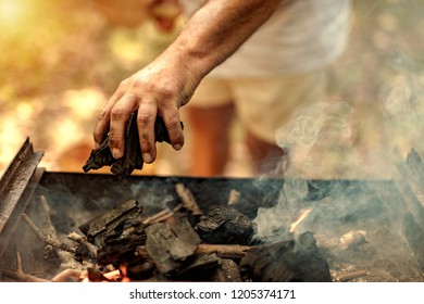 leisure, food, people and holidays concept - man cooking meat on barbecue grill