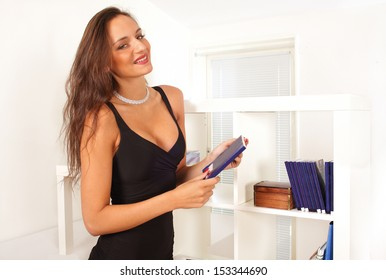 Leisure lifestyle lady chooses a book with smile