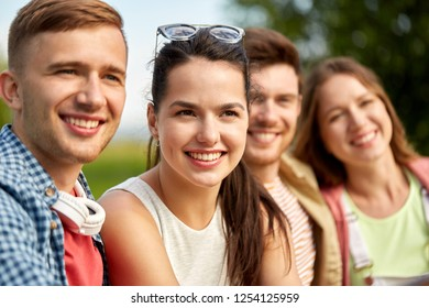 leisure, people and friendship concept - happy teenage friends outdoors in summer