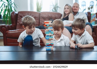 Leisure and relaxed lifestyle of caucasian family. Little brothers have fun and play board game competing at home.