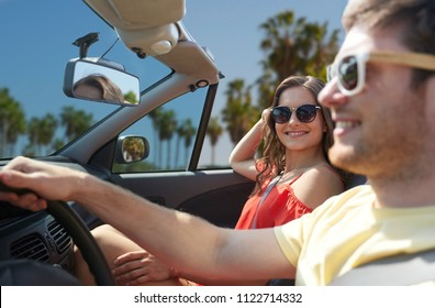 leisure, road trip, travel, summer holidays and people concept - happy couple driving in convertible car over venice beach background in california