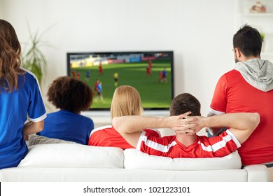 leisure, sport and entertainment concept - friends or football fans watching soccer game on tv at home