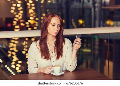 leisure, technology, lifestyle and people concept - woman with smartphone and coffee at restaurant
