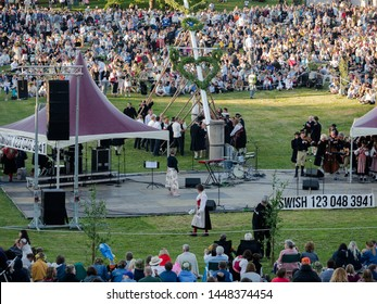 """Leksand, Sweden - 2019.06.21: Traditional Swedish midsummer celebration in the famous """"Gropen"""" in Leksand, Sweden. This is an annual event that celebrates Swedens history and culture."""