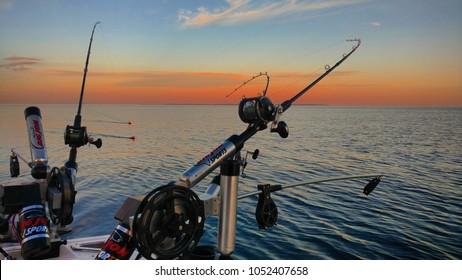 Leland, Michigan, USA - August 2, 2016: Downriggers on salmon fishing boat off the coast of Leland.