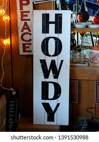 """Leland, Michigan/USA-September 2018:  White sign with black letters in gift shop, """"Howdy."""""""