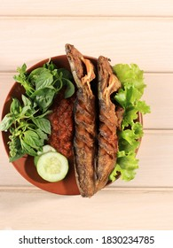 Lele Goreng or Fried Catfish is Traditional Indonesian Culinary Food. Catfish and Chilli Tomato Paste, Popular Street Food Called Pecel Lele Lamongan. Top View