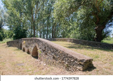 Leles Slovakia 10. july. 2020. St. Gotthard stone bridge on the rivulet Ticce has been built in the middle ages, next to village of Leles. It is a historical monument. The bridge has four  gothic arch