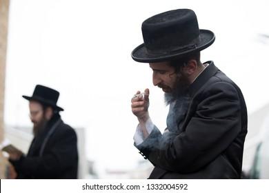 Lelow/Poland- 03 February 2017: Hassidic jew celebrating and praying during Hasidic holiday of the 203 anniversary of tzadik Dawid Biderman's death. Orthodox, hassidic jew smoking cigarette.