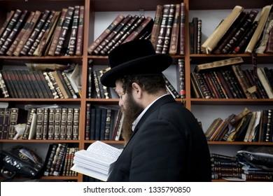 Lelow/Poland- 03 February 2017: Hassidic Jews celebrating, praying, reading during Hasidic holiday of the 203 anniversary of tzadik Dawid Biderman's death