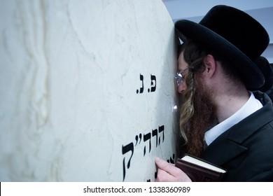 Lelow/Poland- 03 February 2017: Hassidic jew celebrating during Hasidic holiday of the 203 anniversary of tzadik Dawid Biderman's death. Orthodox hasidic Jews praying at the Dawid Biderman's grave.