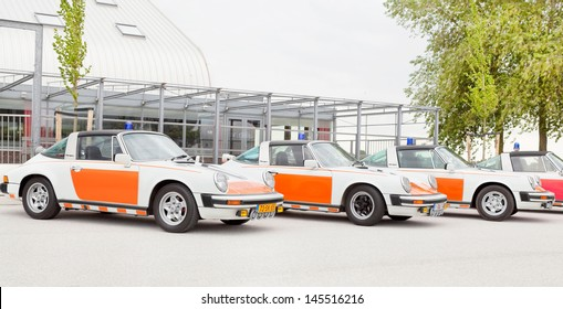LELYSTAD - JUNE 16: Porsche 912 Targa cars used by the Dutch police in 1960s, are on display at the annual National Oldtimer day on June 16, 2013 in Lelystad, The Netherlands