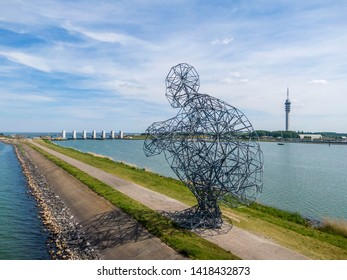 LELYSTAD, NEDERLANDS - JUNE 02, 2019: Huge art object by the famous contemporary sculptor Anthony Gormley