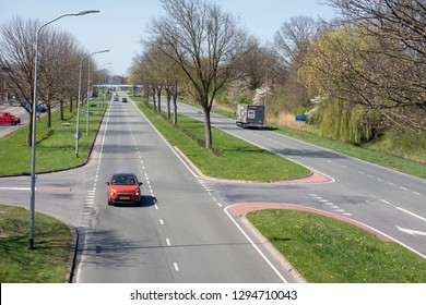 Lelystad, The Netherlands - April 18, 2018: Major road in early springtime along park in Lelystad, capital city of Dutch province Flevoland