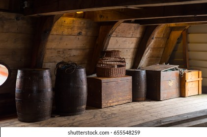 LELYSTAD, NETHERLANDS - AUGUST 7, 2016: wooden crates and barrels on board of a restored dutch VOC ship