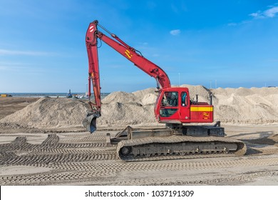 Lelystad, The Netherlands - February 02, 2018: Crane operator in excavator at construction site for building a new harbor near lelystad in The Netherlands