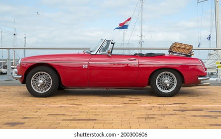 LELYSTAD, THE NETHERLANDS - JUNE 15, 2014: 1967 Red MG B car on display during the annual National Oldtimer day