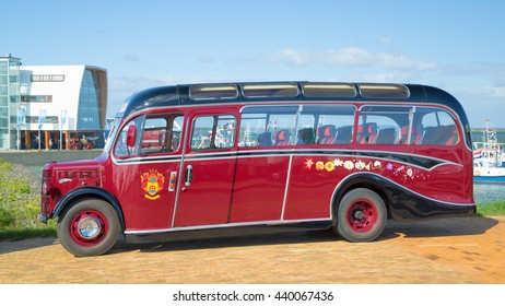 LELYSTAD, THE NETHERLANDS - JUNE 19, 2016: 1950 Bedford OB Duple Bus on display during the annual National Oldtimer day. Non-ticketed public event held in the streets of the city