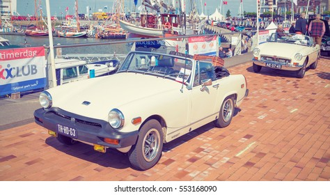 LELYSTAD, THE NETHERLANDS - JUNE 19, 2016: 1979 MG Midget on display during the annual National Oldtimer day. Non-ticketed public event held in the streets of the city. Instagram-like filter applied
