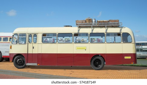 LELYSTAD, THE NETHERLANDS - JUNE 19, 2016: 1962 Bedford 350 Single deck bus on display during the annual National Oldtimer day. Non-ticketed public event held in the streets of the city
