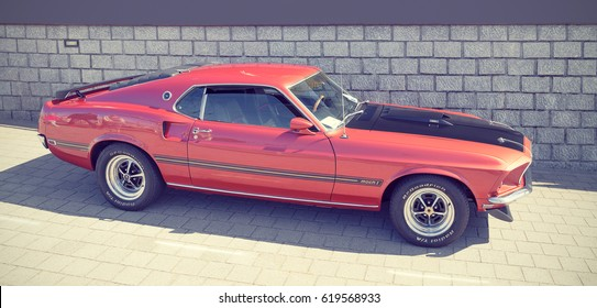 LELYSTAD, THE NETHERLANDS - JUNE 19, 2016: 1969 Ford Mustang Sportsroof Mach 1 on display during the annual National Oldtimer day. Non-ticketed public event held in the city streets. Instagram effect.