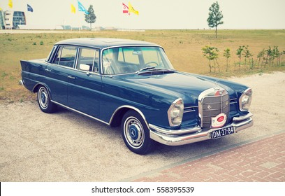LELYSTAD, THE NETHERLANDS - JUNE 21, 2015: 1965 Mercedes Benz 220 B Heckflosse on display during the annual National Oldtimer day. Non-ticketed public event held in the streets. Instagram-like filter.