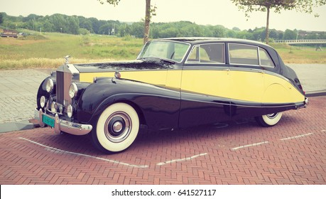 LELYSTAD, THE NETHERLANDS - JUNE 21, 2015: 1957 Rolls-Royce Silver Wraith on display during the annual National Oldtimer day. Instagram-like filter. Non-ticketed public event held in the streets.