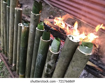 Lemang, made from glutinous rice added with coconut milk and salt then barbecue in hollowed bamboo stick lined with banana leaves and eaten with curry meat dish. A traditional Malay cuisine